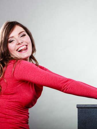 joyous: Happy, joyful, smiling woman stick out her tongue. Joyous female laughing and having fun. Studio shot.