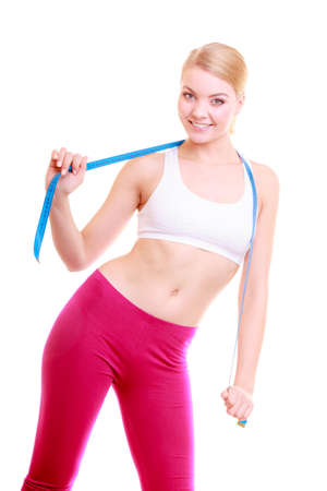 losing control: Time for diet slimming weight loss. Healthy care and healthy nutrition. Young fitness woman fit girl with blue measure tape isolated on white Stock Photo
