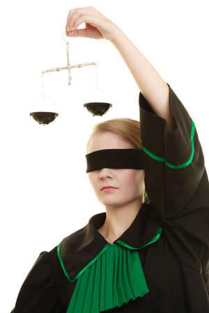 law symbol: Law court concept. Woman lawyer wearing classic polish black green gown with covered eyes holds scales. Femida - symbol sign of justice. isolated on white Stock Photo