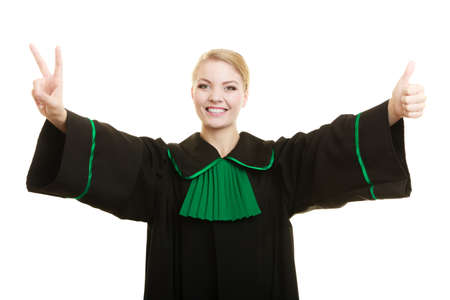 judicature: Law court or justice concept. woman lawyer attorney wearing classic polish black green gown making ok sign victory thumb up hand gesture isolated on white Stock Photo