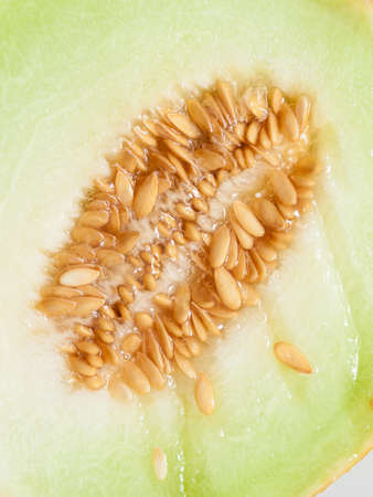 pips: Closeup of melon with pips as food background. Fruit, diet and healthy nutrition.