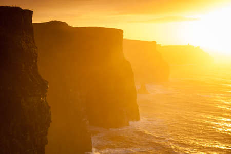 irish landscape: Famous cliffs of Moher at sunset in Co. Clare Ireland Europe. Beautiful landscape natural attraction.