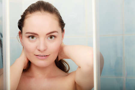 taking shower: Girl taking shower. Young woman taking care of hygiene in bathroom.