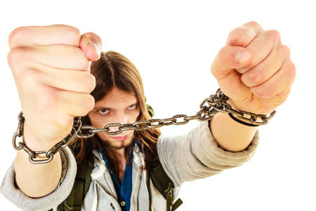 chained: Young man guy slave imprisoned tied with chained hands.