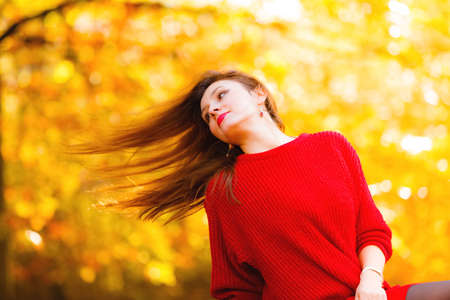 blowing of the wind: Fall lifestyle concept, harmony freedom. Beauty woman portrait with hair blowing on wind, fashion girl relaxing in autumnal park, outdoor