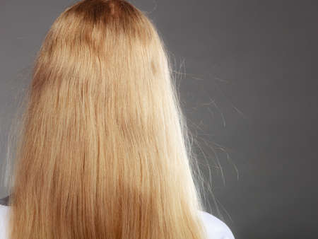 Closeup of woman girl with static blonde long hair.