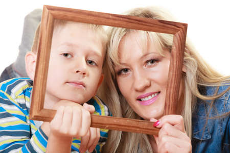 middleaged: Happy family and love concept. Portrait of middle-aged mother with son little boy holding frame decorations studio shot isolated on white