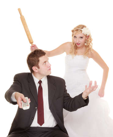 fury: Wedding couple having argument - conflict, bad relationships. Angry woman fury bride holds rolling pin in fight with groom. Isolated