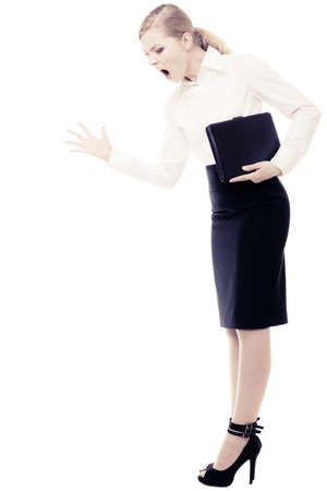 Full length of angry businesswoman boss shouting. Mad furious teacher woman screaming isolated on white. Stress in work. Stock Photo