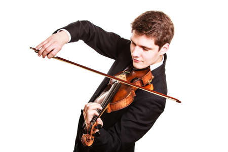 fiddler: Art and artist. Young elegant man violinist fiddler playing violin isolated on white. Classical music. Studio shot.