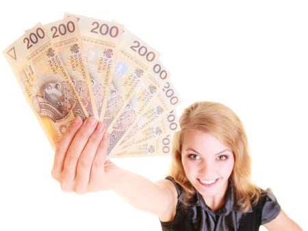 banco dinero: Happy business woman holding polish currency money banknote. Finance savings concept.