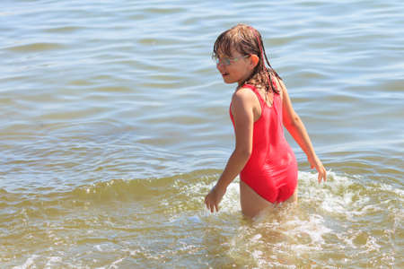 little girl bath: Little girl child having fun in ocean. Kid and woman bathing in sea water. Summer vacation holiday relax.