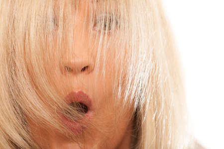 rejuvenation: Healthy hair hairdressing concept. Time for new hairstyling rejuvenation. Woman covering her face with long straight hair, surprised emotion Stock Photo