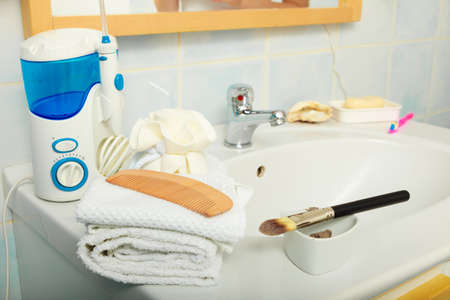 daily room: Closeup bathroom interior with sink faucet many accesories tools for bath hygiene