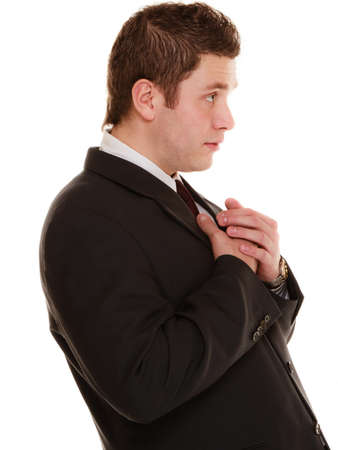 imploring: Facial expression body language. Desperate young man showing clasped hands asking forgiveness, praying isolated