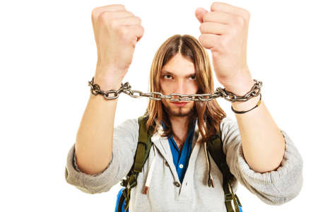 slave: Young man guy slave imprisoned tied with chained hands.
