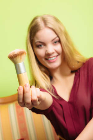 beautify: Young attractive pretty woman girl holding powder brush. Fashion and make up. Stock Photo