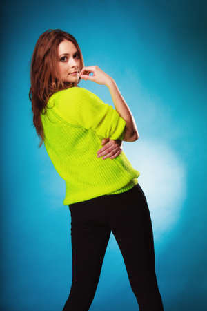 tenager: People teenage concept. Portrait young fashion woman teen girl wearing vivid colour sweater on blue Stock Photo