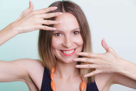 gorgeous girl: Portrait of attractive gorgeous happy joyful woman girl showing hands palms.