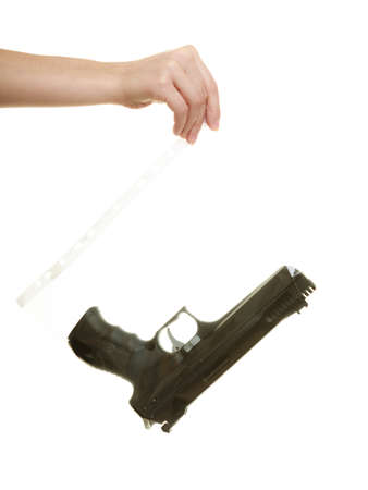 criminology: Law court or justice concept. Woman lawyer attorney hand  holding weapon gun - bag marked evidence for crime. isolated on white