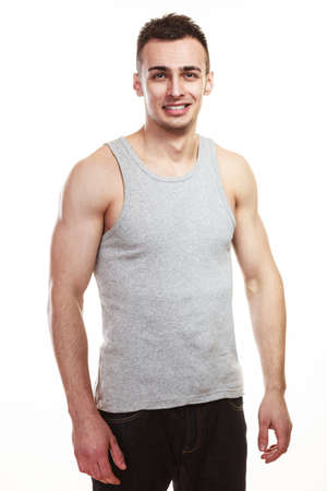 muscled: Handsome muscled sporty fit man. Portrait of young muscular guy isolated on white. Healthy lifestyle.