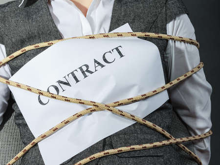 bound woman: Closeup of businesswoman bound by contract terms and conditions. Woman tied becoming slave. Business and law concept. Stock Photo