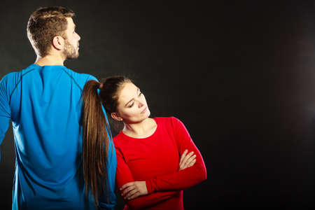 not talking: Offended upset young couple not talking to each other standing back to back after argument quarrel. Unhappy man and woman. Disagreement in relationship. Stock Photo