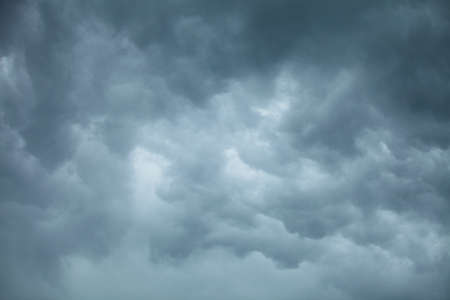 meteorology: Dramatic cloudscape. Dark stormy clouds covering the sky as nature background. Meteorology.