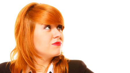 haired: Women in business. Job concept. Disappointed young red haired businesswoman portrait on white background in studio.