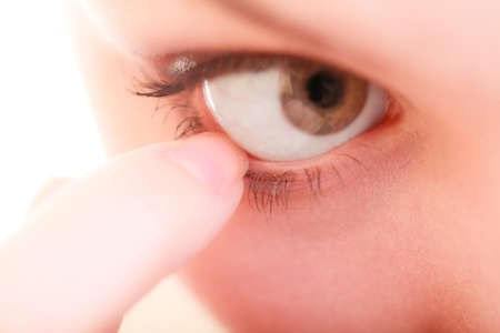 foreign bodies: Part of face female eyes. Medicine healthcare human eye pain foreign body.