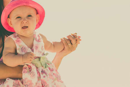 babyhood: Closeup of sweet little baby in parent hands. Babyhood and parenting.