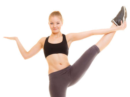zumba: Sport and active lifestyle. fitness sporty girl stretching showing open hand palm with blank copy space for product or text isolated. Stock Photo