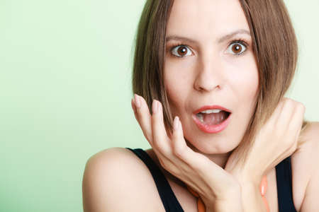 emotional woman: Emotional facial expression wide eyed woman surprised girl open mouth hand gesture. Stock Photo