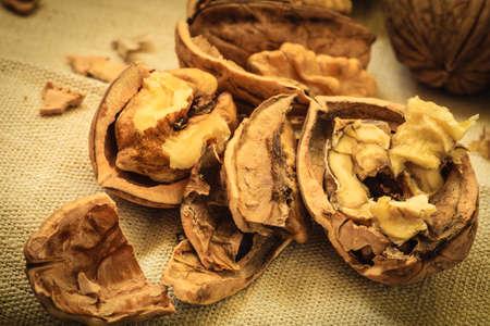 omega3: Healthy food full of omega-3 fatty acids, organic nutrition. Walnut kernels on burlap rustic old table