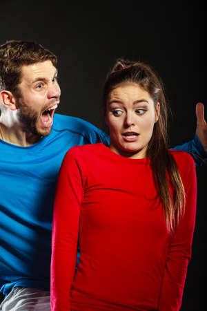 aggresive: Husband abusing wife. Aggresive man screaming at scared afraid woman. Domestic violence aggression. Bad relationship.
