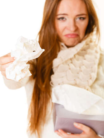 ilness: Sick woman heat dressed with flu holding tissue box. Rhinitis and cold in winter time.