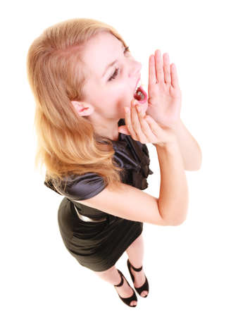 calling for help: young woman blonde buisnesswoman in black dress shouting screaming. girl calling for help isolated on white