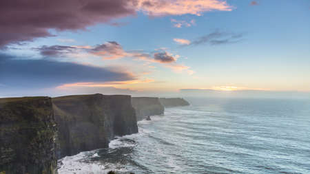 irish landscape: Famous cliffs of Moher at sunset in Co. Clare Ireland Europe. Beautiful landscape as natural attraction. Stock Photo