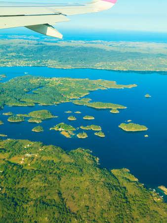 birds eye: Birds eye. View from window of plane airplane flying over Norway Scandinavia.