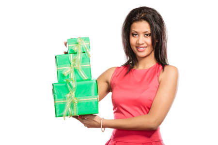multiple ethnicity: Pretty happy mixed race woman with green boxes gifts isolated on white. Birthday anniversary concept. Stock Photo