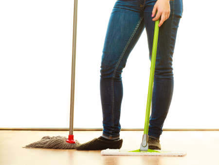 cleanup: Cleanup housework concept. Cleaning woman legs, girl mopping floor, holding two mops new and old white background