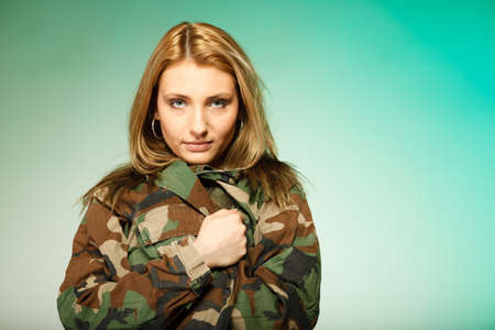 army girl: Beautiful sexy woman in military clothes fit army girl portrait on green