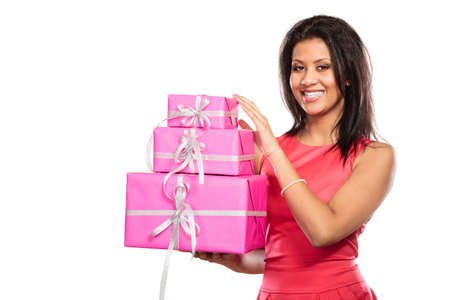 multiple ethnicity: Pretty happy mixed race woman with pink rose boxes gifts isolated on white. Christmas xmas winter time season concept.