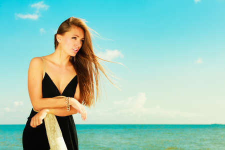 beautiful weather: Holidays, vacation travel and freedom concept. Portrait of attractive sensual girl beauty long hair on seaside. Young pretty tanned woman in summer dress relaxing on the sea coast Stock Photo