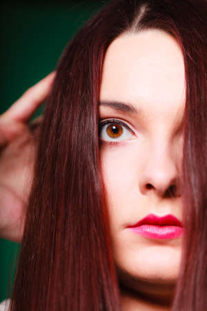 scare: Panic, fear and scare. Beauty terrified woman face. Close up shot on green background in studio. Stock Photo