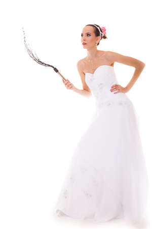 Wedding day. Full length young attractive bride in white dress with black leather flogging whip isolated on white background