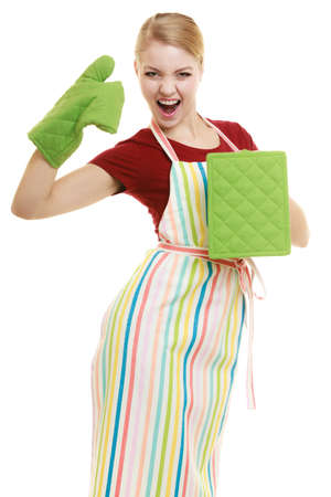 business cloth: Funny housewife in striped kitchen apron or small business owner entrepreneur holds oven glove cloth isolated on white