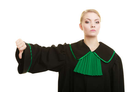 judicature: Law court or justice concept. Portrait young woman lawyer attorney wearing polish Poland black green gown making thumb down hand sign on white