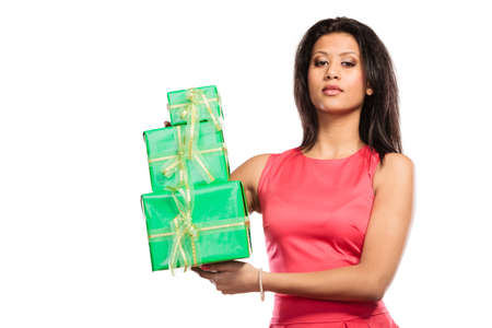 multiple ethnicities: Pretty fashion mixed race woman with green boxes gifts isolated on white. Birthday anniversary concept.