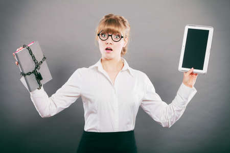 chained: Businesswoman holding document and tablet. Woman with padlock chained file and pc digital computer.